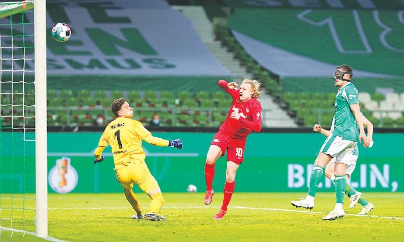 RB LEIPZIG'S Emil Forsberg scores against Werder Bremen during their German Cup semi-final at the Weser-Stadion.—Reuters