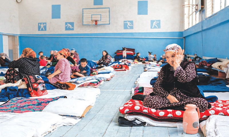 Kyrgyz citizens, who were evacuated from districts bordering Tajikistan are seen inside of a school in southwestern town of Batken on Saturday. — AFP