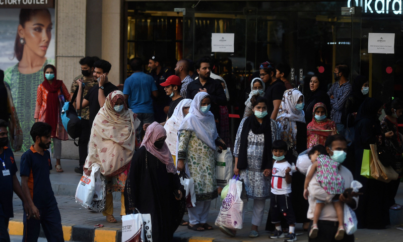 People crowd in a market area for shopping during Ramazan in Karachi on Saturday. — AFP