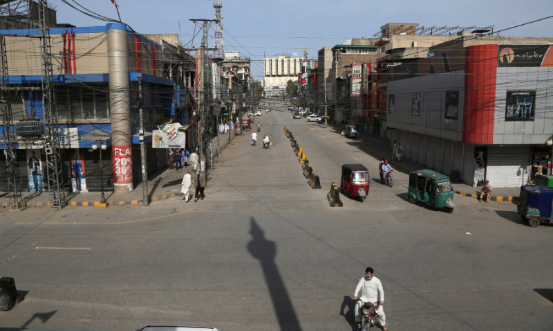 Few people walk through a market area closed due to new government instruction to control the spread of the coronavirus, in Peshawar in this file photo. — AP