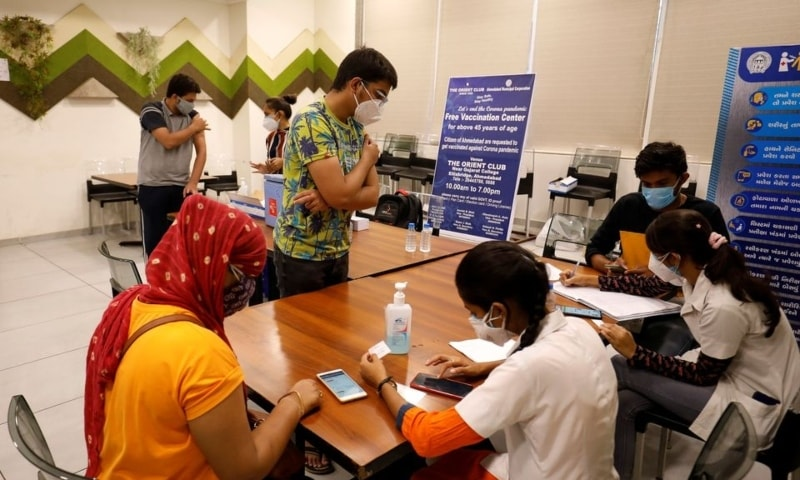 People get their names registered after receiving a dose of Covishield, a Covid-19 vaccine manufactured by Serum Institute of India, at a vaccination centre in Ahmedabad, India, May 1. — Reuters