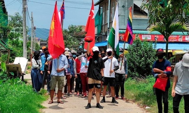 Demonstrators carry flags as they march to protest against the military coup, in Dawei, Myanmar, April 27. — Reuters