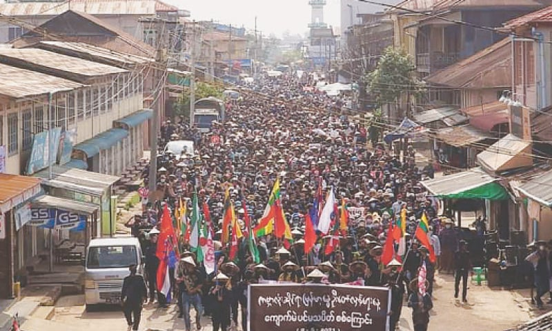 KYAUKME: Protesters taking part in a demonstration against the military coup in Myanmar's Shan state on Sunday. Cities, rural areas, remote mountainous regions and even rebel-controlled border territories have been in uproar since the military ousted civilian leader Aung San Suu Kyi on Feb 1.—AFP