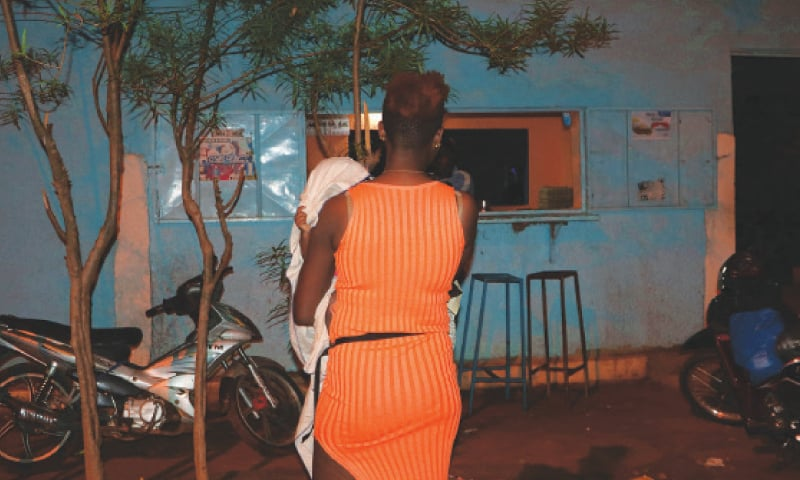 A Nigerian sex worker and her child arrive at a bar in Burkina Faso's town of Bobo-Dioulasso, 360km west of Ouagadougou.—AP