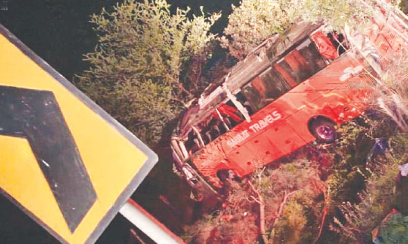 A VIEW of the bus after it plunged into the ditch as the driver tried to overtake a car.—INP