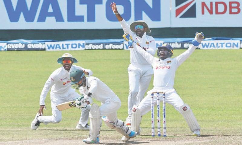 PALLEKELE: Sri Lankan players appeal successfully for the dismissal of Bangladesh batsman Liton Das during the final Test at the Pallekele International Cricket Stadium on Monday.—AFP