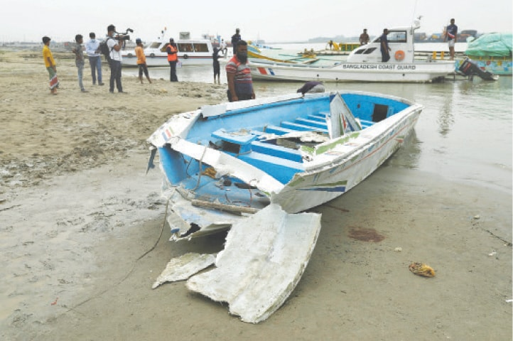 THE speedboat is seen ashore after it sank on Padma River near Madaripur.—Reuters