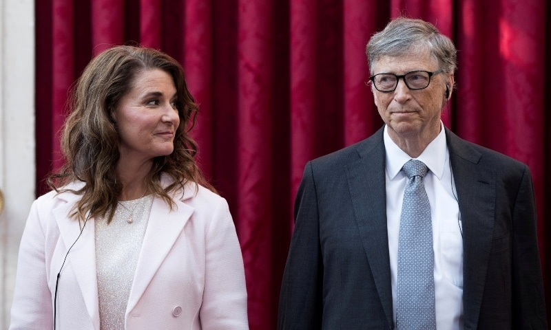 Philanthropist and co-founder of Microsoft, Bill Gates (R) and his wife Melinda listen to the speech by French President Francois Hollande, prior to being awarded Commanders of the Legion of Honor at the Elysee Palace in Paris in 2017. — Reuters