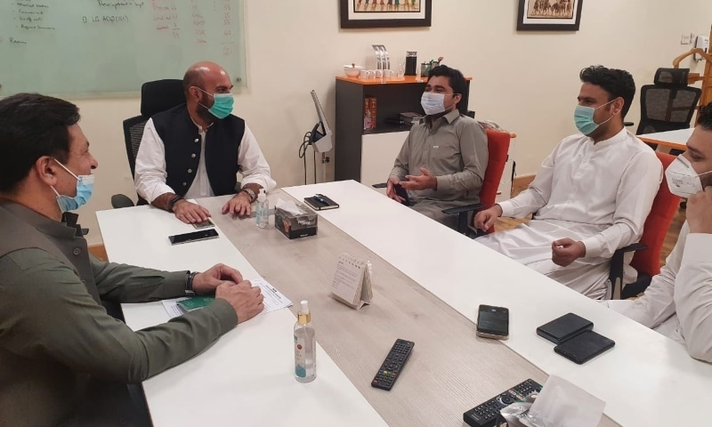 Health minister Taimur Jhagra meets representatives from the Hayatabad Medical Complex. - Photo courtesy Twitter