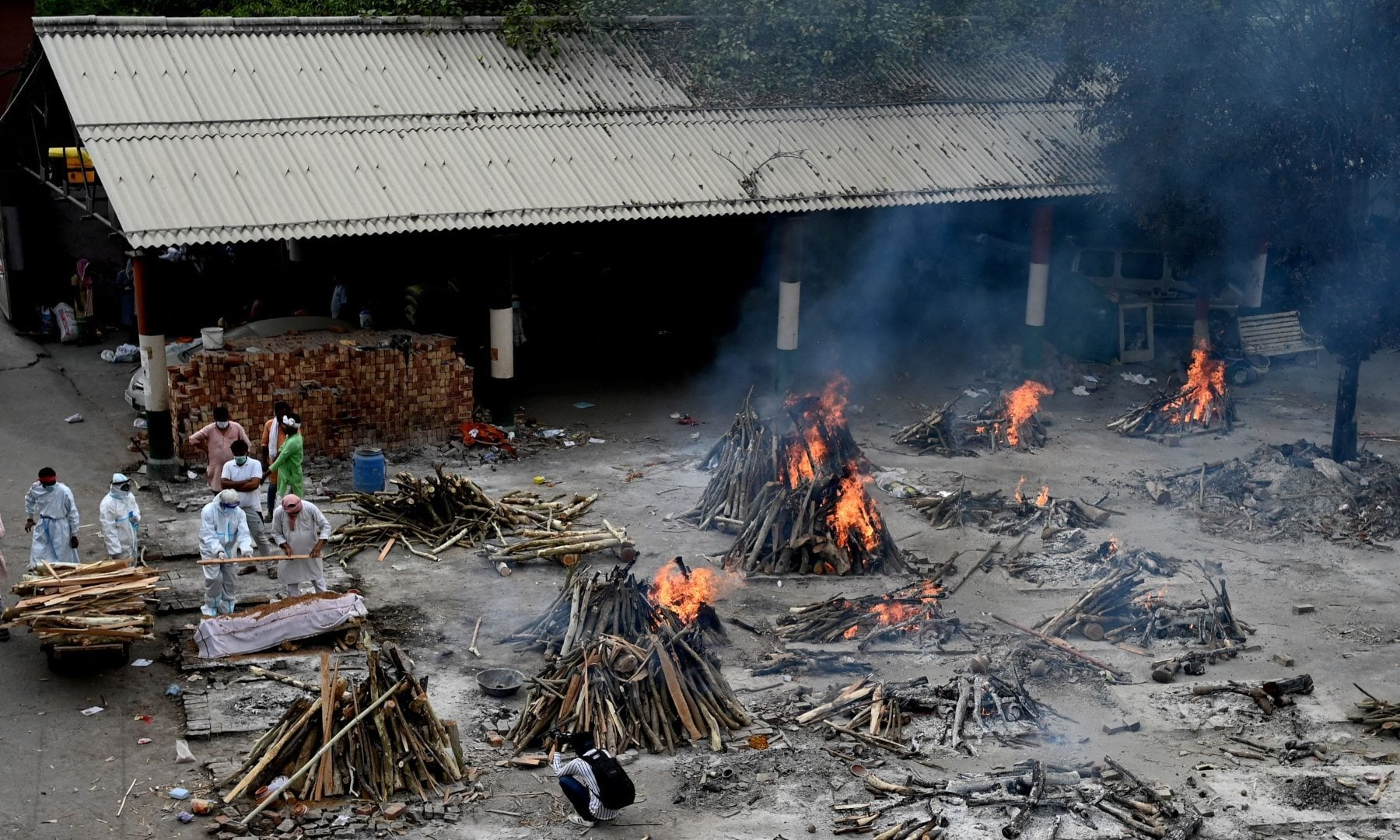 Funeral pyres of people who died due to Covid-19 are seen at a cremation ground in New Delhi on May 4. — AFP