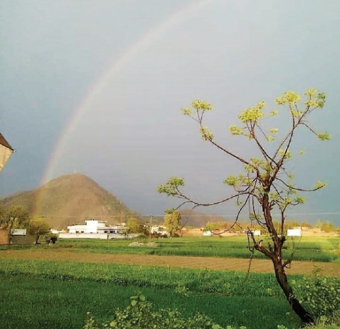 A rainbow appears in the sky on a rainy day in Swabi. — Dawn