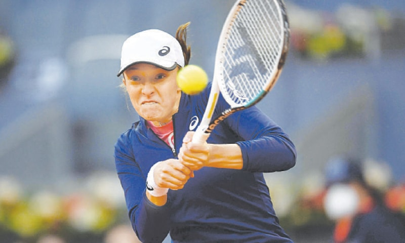 IGA Swiatek of Poland in action against Australia's Ashleigh Barty during their Madrid Open match at the Caja Magica.—AFP