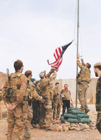 PHOTO taken on Sunday shows a ceremony at Camp Anthonic in Helmand province during which control of the area was handed over by US troops to Afghan forces.—Reuters
