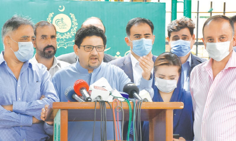 ISLAMABAD: Miftah Ismail addressing a press conference along with other PML-N leaders after a hearing by the Election Commission on his application on Tuesday.—Online