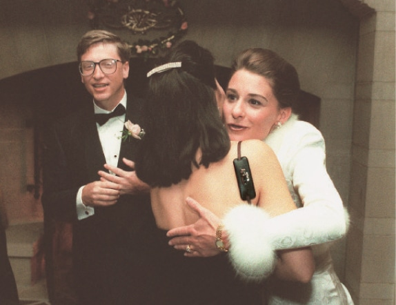 A JAN 9, 1994, file photo shows computer mogul Bill Gates and bride, Melinda French, greeting guests in a reception line at a private estate in Seattle.—AP