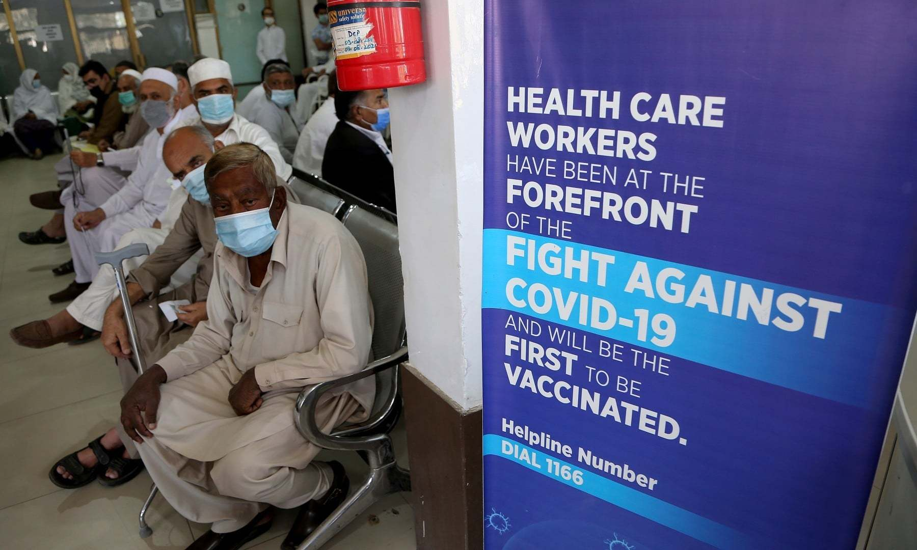 People wait their turn to receive the second shot of the Sinopharm Covid-19 vaccine at a vaccination centre in Peshawar on April 21. — AP/File