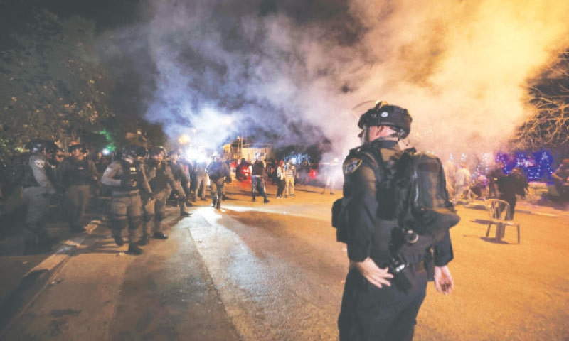 Jerusalem: Israeli forces use tear gas to disperse Palestinians protesting eviction from their homes in Sheikh Jarrah neighbourhood of occupied east Jerusalem. Israeli Jews have taken over houses on the grounds that Jewish families lived there before fleeing in 1948. The claimants seek to evict 58 more Palestinians and  Israel's supreme court is set to announce a decision for four of those families on Thursday.—AFP