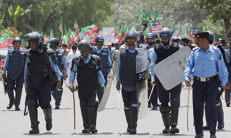 A complainant has withdrawn a petition filed against 'highhandedness' of Islamabad police officials who raided her house at mid-night without warrants and lady constables. — AP/File