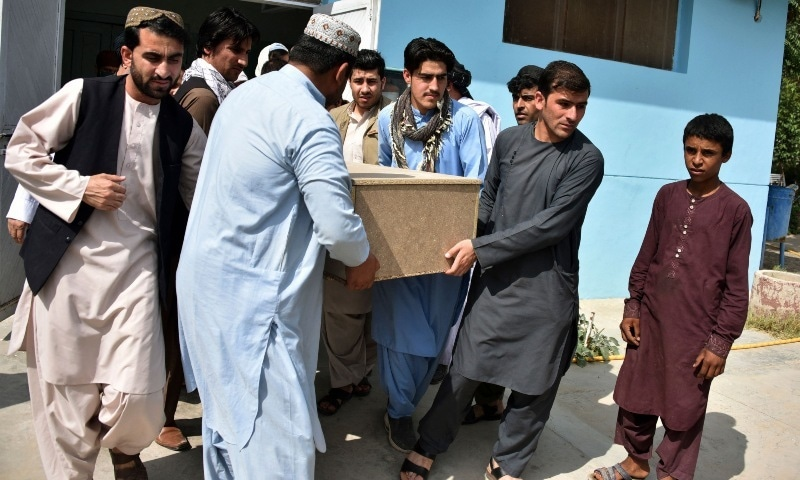 Relatives carry a coffin with the body of Nemat Rawan after he was shot dead by gunmen in Kandahar province on May 6. — AFP