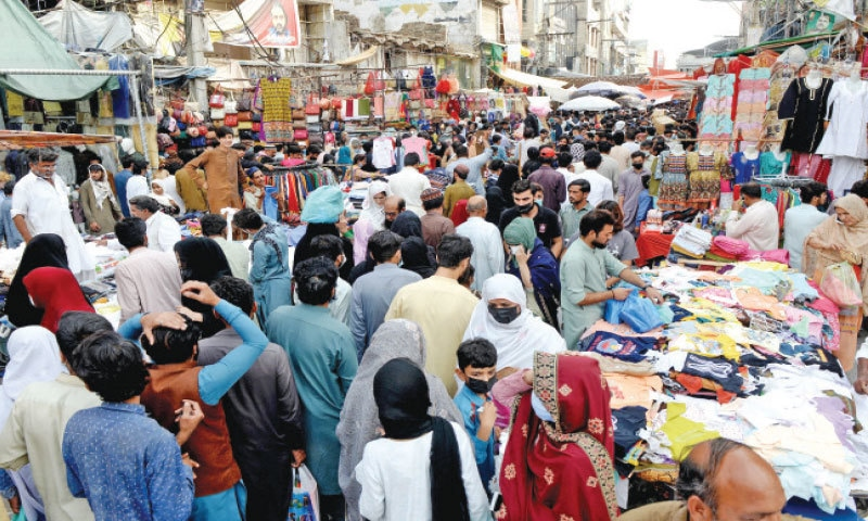 People throng Moti Bazaar in Rawalpindi for Eid shopping on Thursday ahead of May 8 to 16 lockdown announced by government. — Photo by Mohammad Asim