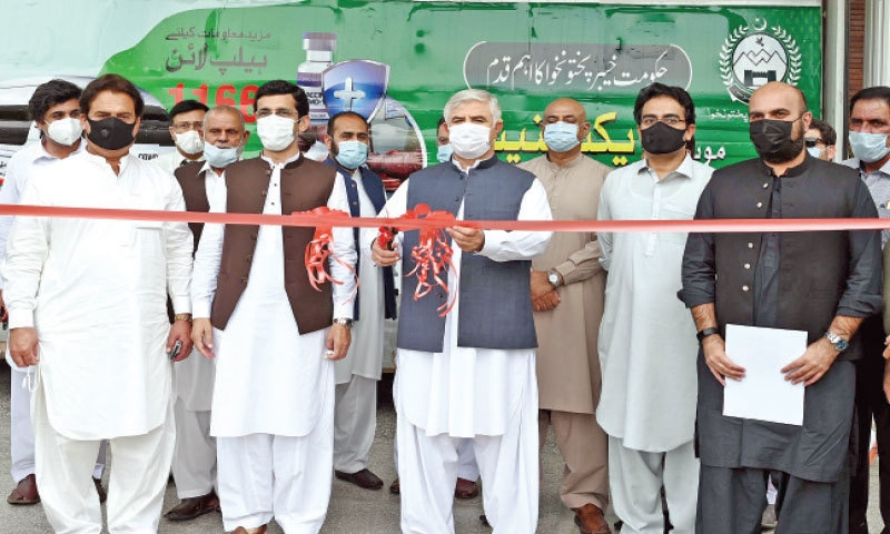 Chief Minister Mahmood Khan inaugurates the mobile Covid vaccination service in Peshawar on Thursday.