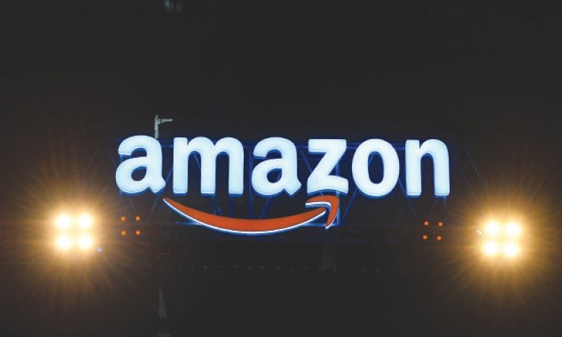 In this file photo, an Amazon logo is pictured during the Amazon's annual Smbhav event in New Delhi. —AFP/File