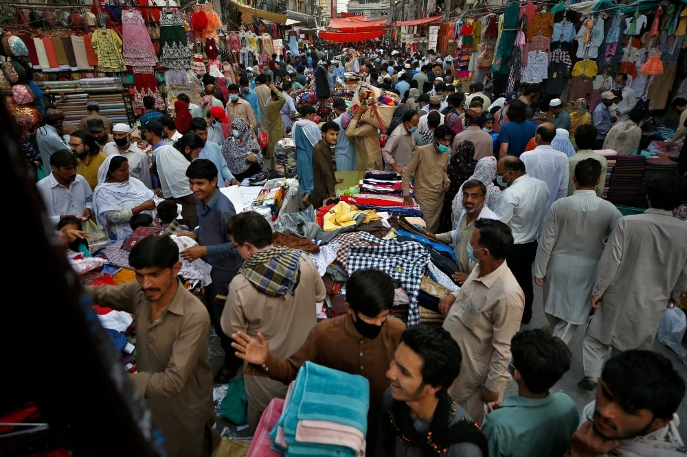 In this May 5 file photo, people ignore social distancing and many do not wear face masks as they shop for Eid. — AP