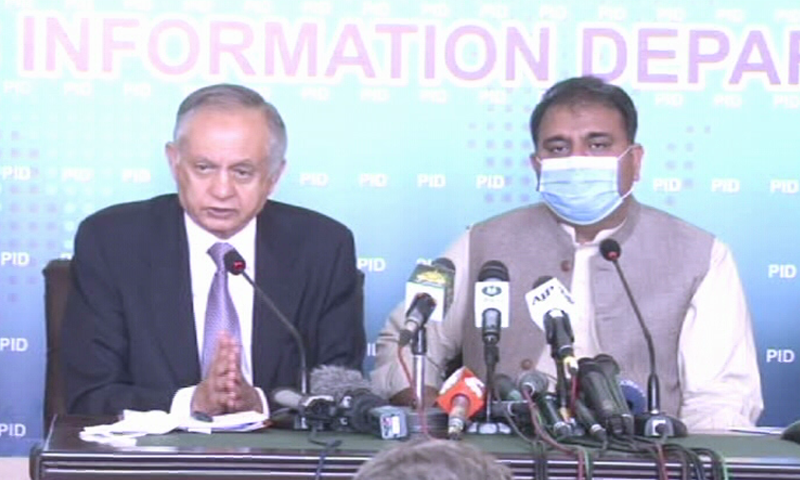 Information Minister Fawad Chaudhry and Commerce Adviser Abdul Razak Dawood address a press conference in Islamabad. — DawnNewsTV