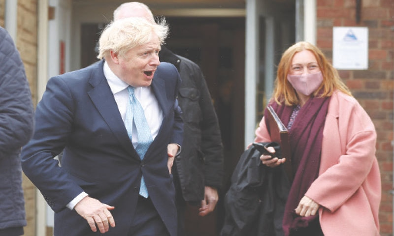 HARTLEPOOL: Prime Minister Boris Johnson reacts during his visit to Jacksons Wharf Marina on Friday. — Reuters