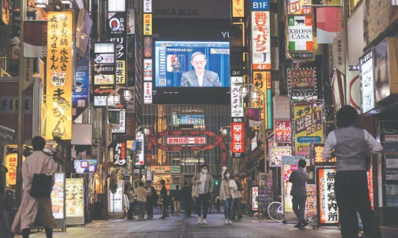 TOKYO: A television screen shows Japanese Prime Minister Yoshihide Suga speaking during a press conference to announce the extension of a coronavirus state of emergency.—AFP