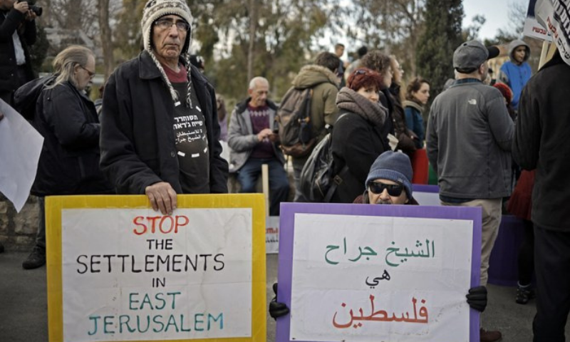This file photo shows protesters near the house of a Palestinian family, which an Israeli court had ordered to be evicted while declaring Israeli settlers to be the legal owners in Sheikh Jarrah, Jerusalem. — AFP