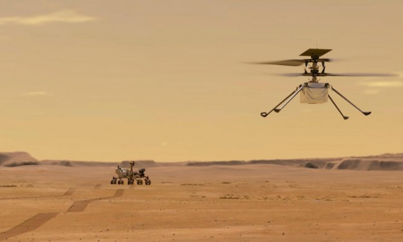 This Nasa photo shows an illustration depicting Mars Helicopter Ingenuity during a test flight on Mars. — AFP/File