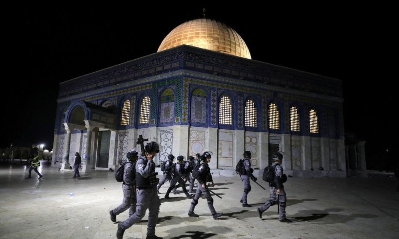 Israeli police walk near the Dome of the Rock during clashes with Palestinians at a compound known to Muslims as Noble Sanctuary and to Jews as Temple Mount, amid tension over the possible eviction of several Palestinian families from homes on land claimed by Jewish settlers in the Sheikh Jarrah neighbourhood, in Jerusalem's Old City on Friday. — Reuters