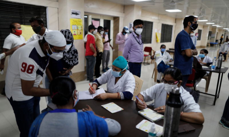 Indians register themselves to receive the vaccine for Covid-19 at a medical college in Prayagraj, India. — AP
