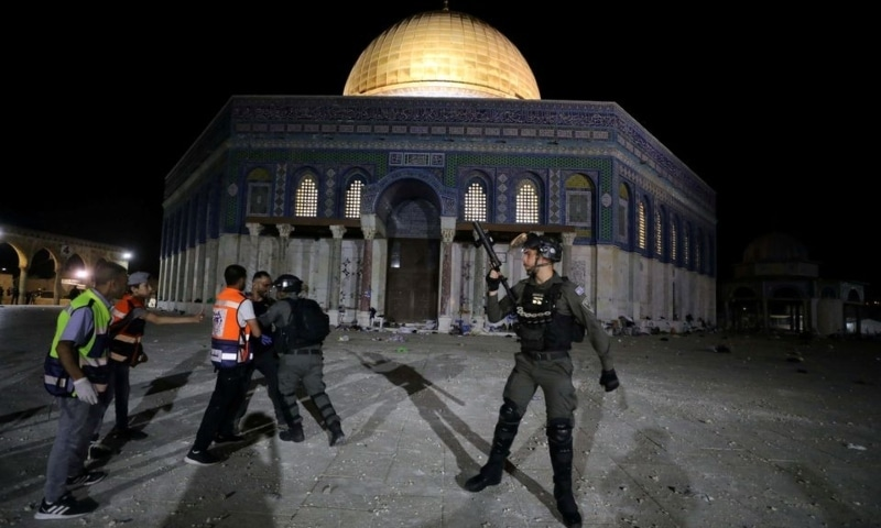 An Israeli policeman scuffles with a Palestinian in front of the Dome of the Rock during clashes, amid tension over the possible eviction of several Palestinian families from homes on land claimed by Jewish settlers in the Sheikh Jarrah neighbourhood on May 7. — Reuters