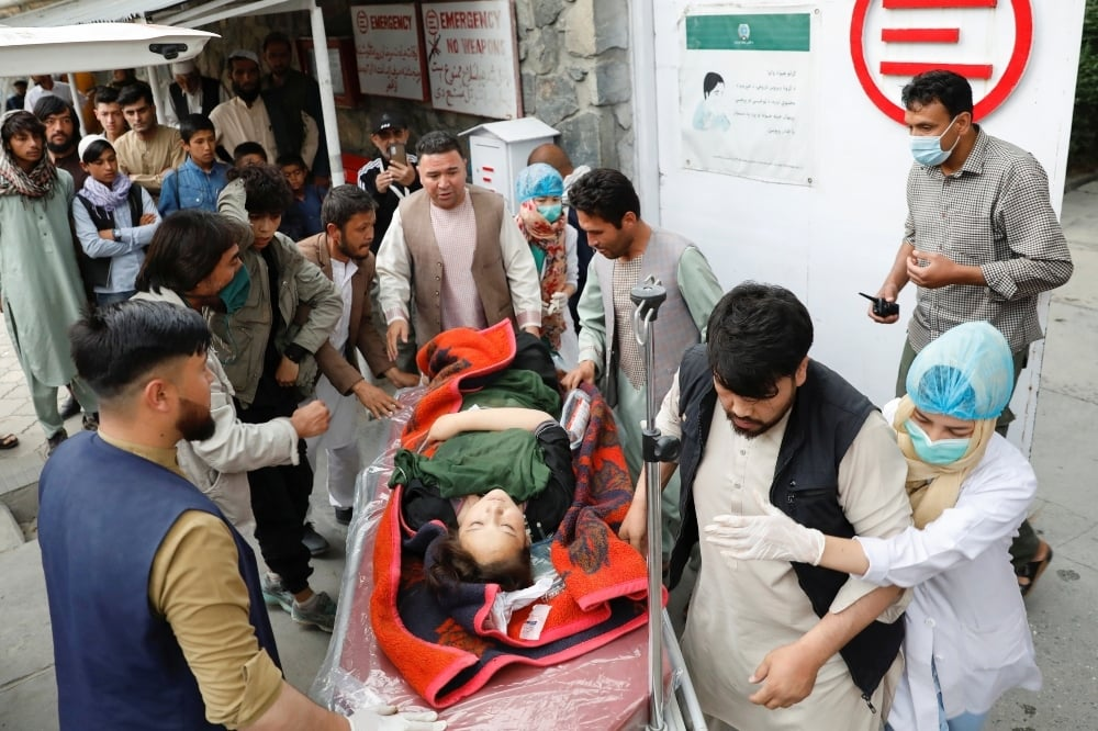 An injured woman is transported to a hospital after a blast in Kabul on May 8. —  Reuters