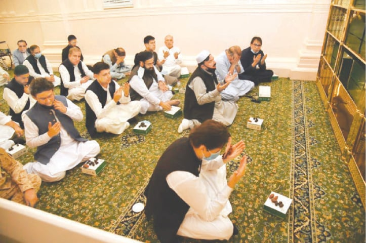 Prime Minister Imran Khan, accompanied by cabinet members, prays at Roza-i-Rasool (PBUH) on Saturday.