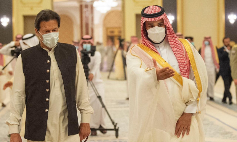Saudi Crown Prince Mohammed bin Salman greets Prime Minister Imran Khan before signing cooperation agreements at the royal palace in Jeddah, Saudi Arabia on Saturday. — Photo courtesy PM Office Twitter