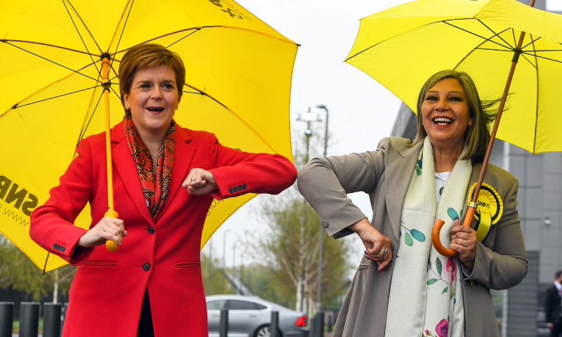 Scotland's First Minister and leader of the Scottish National Party (SNP), Nicola Sturgeon (L) congratulates SNP candidate Kaukab Stewart after she was elected MSP for Glasgow Kelvin in the Scottish Parliamentary Election, in Glasgow on Saturday. — AFP