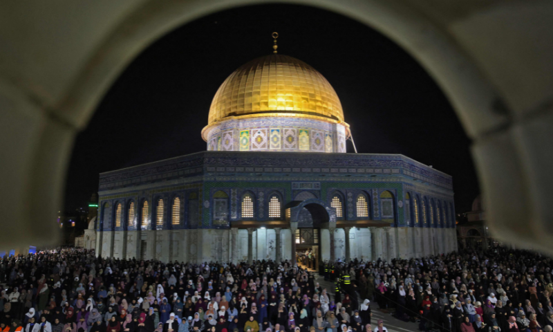 Palestinian devotees pray on Lailatul Qadr outside the Dome of the Rock in Jerusalem's Al-Aqsa Mosque compound on Saturday. — AFP