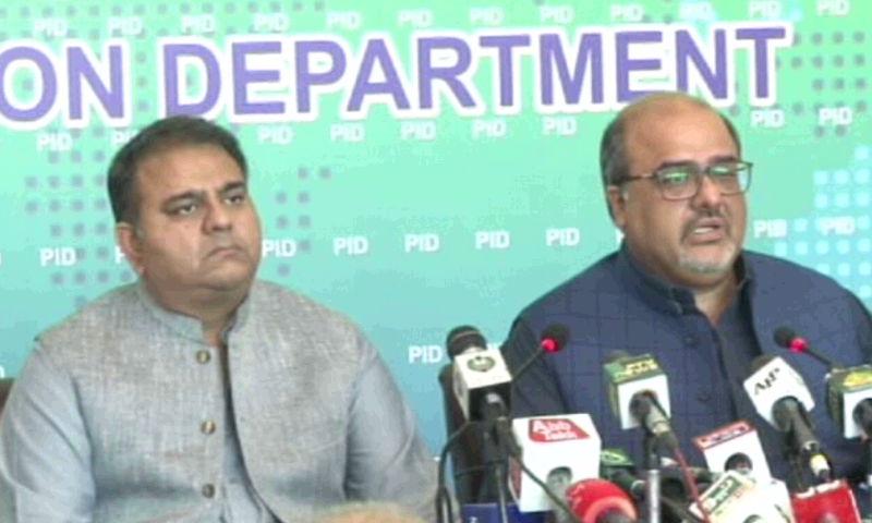 Information Minister Fawad Chaudhry (left) and Adviser to the Prime Minister on Interior and Accountability Mirza Shahzad Akbar address a press conference in Islamabad. — DawnNewsTV