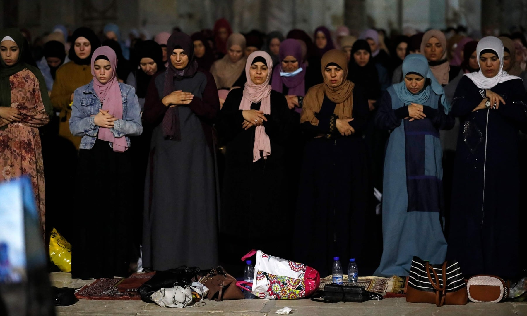 Palestinian devotees pray on Laylat al-Qadr outside the Dome of the Rock in Jerusalem's Al-Aqsa Mosque compound on May 8. — AFP