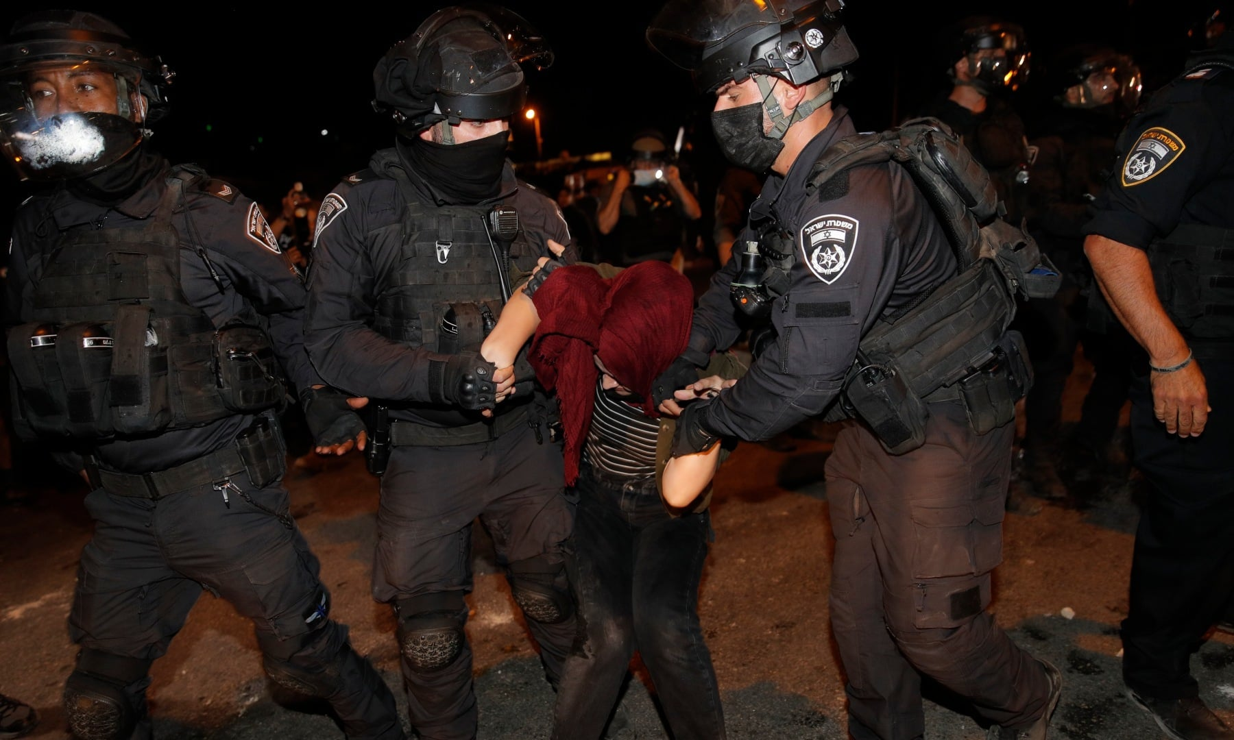 Israeli police officers detain a Palestinian demonstrator during a protest against the planned evictions of Palestinian families in the Sheikh Jarrah neighbourhood of east Jerusalem, Saturday, May 8. — AP