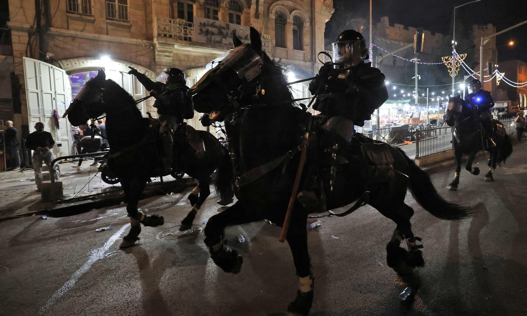 Israeli mounted police deploy to disperse Palestinian protesters outside the Damascus Gate in Jerusalem's Old City on May 8. — AFP