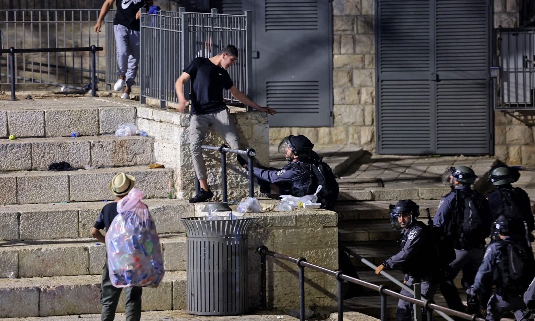 Israeli security forces try to detain a Palestinian protester outside the Damascus Gate in Jerusalem's Old City on May 8. — AFP