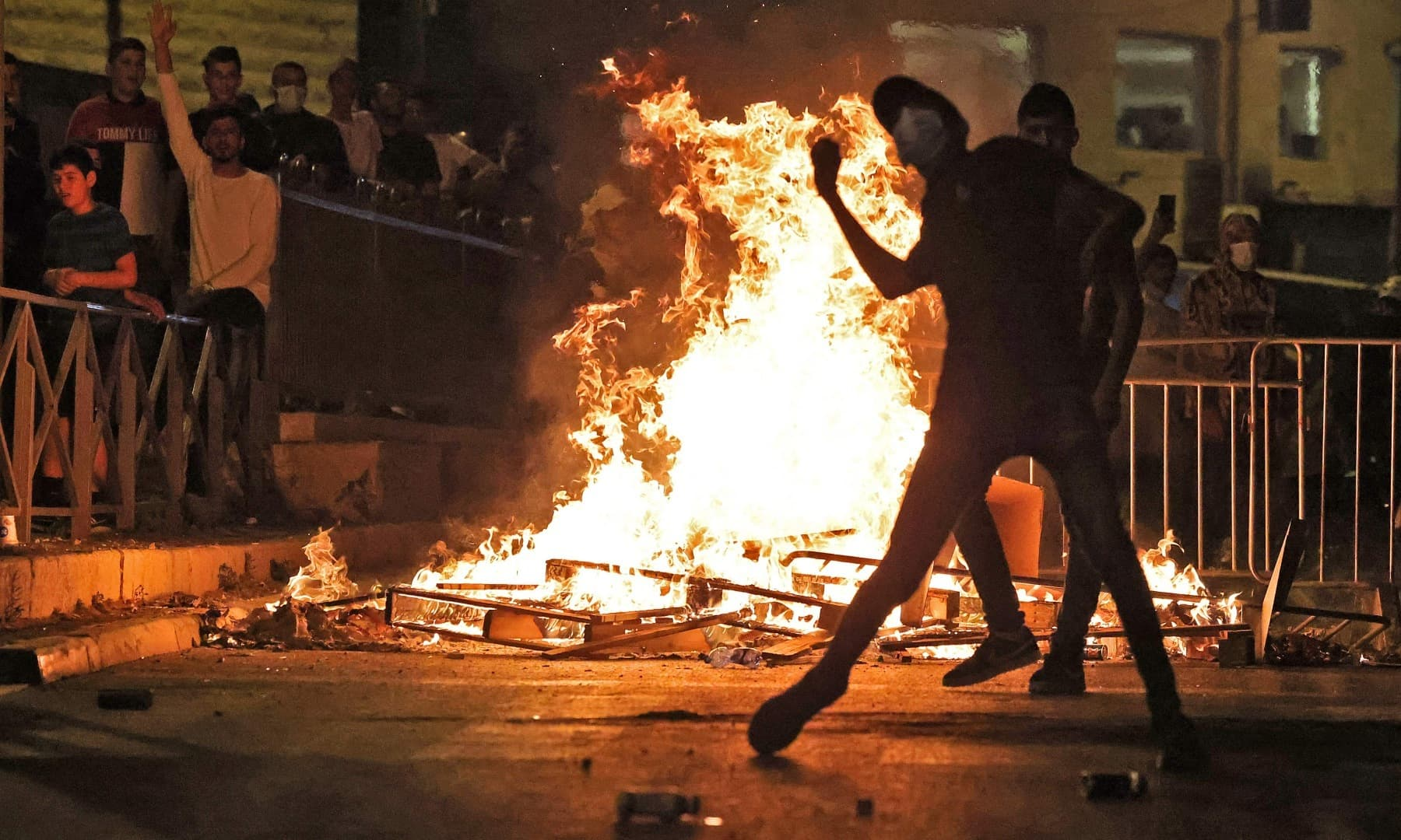 A Palestinian protester hurls stones at Israeli security forces in Jerusalem's Old City on May 8. — AFP