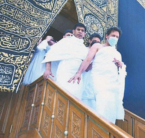 PRIME Minister Imran Khan coming out of Khana Kaaba on Sunday.—APP