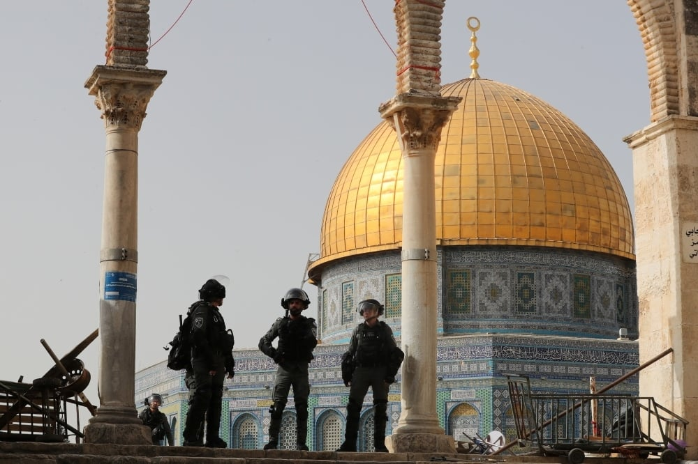 Israeli police stand in front of the Dome of the Rock during violence at the compound that houses Al-Aqsa Mosque, on May 10. — Reuters