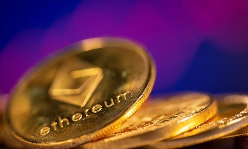 Representations of virtual currency Ethereum are seen in front of a stock graph in this illustration taken February 19. — Reuters