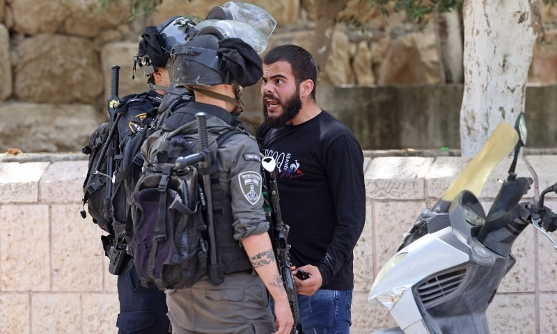 A Palestinian protester argues with Israeli security forces in Jerusalem's Old City on May 10, 2021, as a planned march marking Israel's 1967 takeover of the holy city threatened to further inflame tensions. — AFP